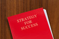 Strategy for success red folder on desk with title shot from above Royalty Free Stock Image