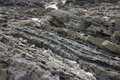 Stratified rocks in a cliff face Royalty Free Stock Photo