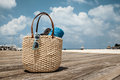 Straw bag on the wooden bridge at tropical beach, Mexico Royalty Free Stock Photo