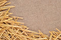 Straw on burlap as background texture Royalty Free Stock Photos