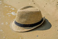Straw hat on the beach lying in sand Royalty Free Stock Image