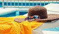 Straw hat with towel Royalty Free Stock Photo