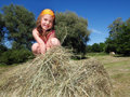On the straw little happy girl playing in hay Stock Photography