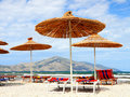 Straw parasols on the beach Royalty Free Stock Images