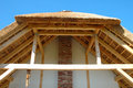 Straw roof covered with and it s wooden construction Stock Photos