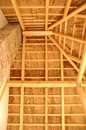 Straw roof covered with and it s wooden construction Royalty Free Stock Images