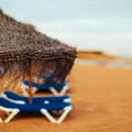 Straw umbrella on the beach close up Royalty Free Stock Image