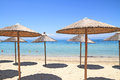 Straw umbrellas by the sea on exotic resort thassos island greece Royalty Free Stock Images