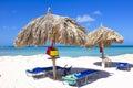 Straw umbrellas on a tropical beach Royalty Free Stock Photo