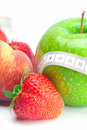 Strawberries,apple,peas,peach and tape Royalty Free Stock Image