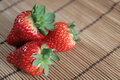 Strawberries on a bamboo table mat Royalty Free Stock Photos
