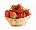 Strawberries in a basket fresh on white background Stock Photos