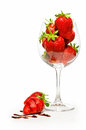Strawberries in a big wine glass on a white background with clipping path Stock Photos