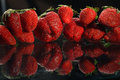Strawberries on  black background Royalty Free Stock Photo