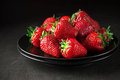 Strawberries in black plate Royalty Free Stock Photo