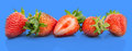 Strawberries on blue background Royalty Free Stock Photo