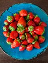Strawberries on a blue plate Royalty Free Stock Photo