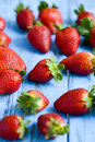 Strawberries on a blue wooden surface Royalty Free Stock Photo