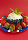Strawberries, blueberries and cream Stock Images