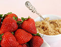 Strawberries and Brown Sugar Royalty Free Stock Photos