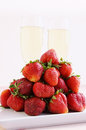 Strawberries and champagne glasses big pile of Stock Photography