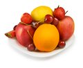 Strawberries cherry apple orange and lemon image of on the plate closeup Royalty Free Stock Image