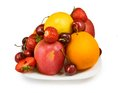 Strawberries cherry apple orange and lemon isolated image of on the plate closeup Stock Image