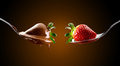 Strawberries and chocolate cream poured over a bed of Royalty Free Stock Image
