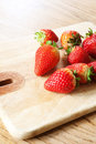 Strawberries on a chopping board Stock Photo
