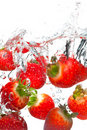 Strawberries falling in water Stock Photography