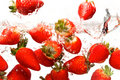 Strawberries falling in water Royalty Free Stock Photo