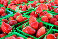 Strawberries at farmer s market a collection of fresh are gathered in baskets on a sale table a Royalty Free Stock Image