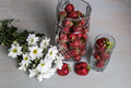 Strawberries and flowers in a jar white chrysanthemums Stock Photography