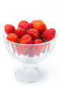 Strawberries in glass bowl on white background selective focus Stock Image