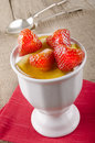 Strawberries with honey and yogurt in a dessert bowl Stock Images