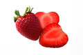 Strawberries on isolated background one whole strawberry with two slices of a strawberry an Royalty Free Stock Photos