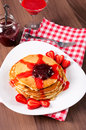Strawberries jam and homemade pancakes fresh on plated with Stock Photography