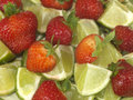 Strawberries with Limes Stock Photography