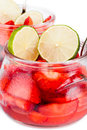 Strawberries and limes pieces of slices of in glass bowl Royalty Free Stock Image