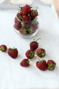 Strawberries lots of ripe red juicy on a blackboard Royalty Free Stock Photography