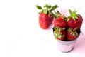 Strawberries lots of ripe red juicy on a blackboard Stock Photo