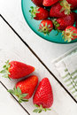 Strawberries many on white wooden table Stock Photos