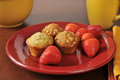 Strawberries and muffins a plate of fresh mini Stock Photography