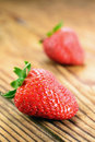Strawberries old wooden table selective focus Royalty Free Stock Photos