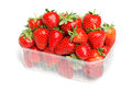 Strawberries in a plastic cup bowl on white background Stock Photos
