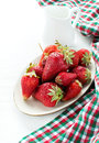 Strawberries on plate and milk over light background selective focus Stock Photo