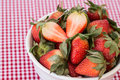 Strawberries on red gingham background in a white ceramic bowl a Royalty Free Stock Photography