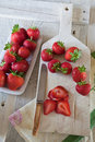 Strawberries sliced on a chopping board Royalty Free Stock Photography
