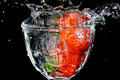 Strawberries splashed in water Royalty Free Stock Images