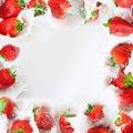 Strawberries splashing into milk frame Royalty Free Stock Photo